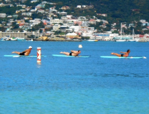 Dennis Hensley, doing yoga paddleboard in the Caribbean, reporting for ManAboutWorld gay travel magazine