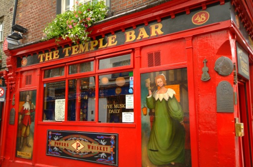 The Temple Bar Pubfront in close up with artwork of medieval characters, Brendan Vacations, Ireland